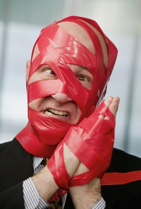 datalite uk business essay grinding square wheels of bureaucracy office man covered in red tape