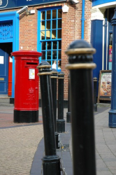 Royal Mail Red Postbox in Empty Street